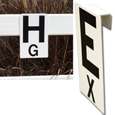 "High quality plaque shows large main letter and smaller  centerline letter. UV treated with silk screened letters for long life. 1 1/2"" channel attached to the back of each plaque. 12"" x 8""."